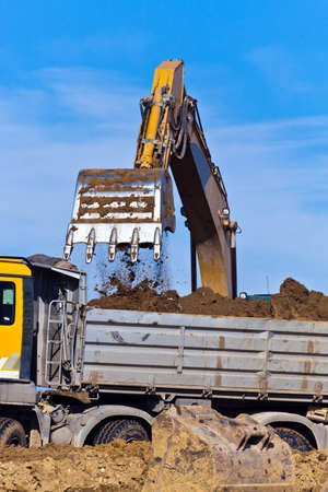 trenching: An excavator on a construction site during construction work. Excavation and dredging. Stock Photo