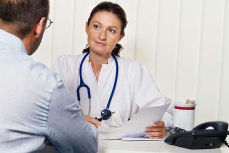 Doctors in medical practice with patients. Discussion for treatment. photo