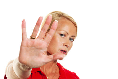 defensive posture: A young woman holding hands in front of her face. Defense against domestic violence. Stock Photo