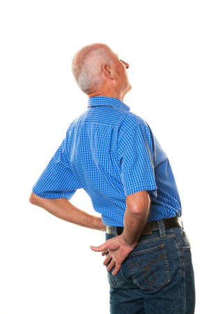 senior pain: An elderly man with back pain. Senior with pain in the back.