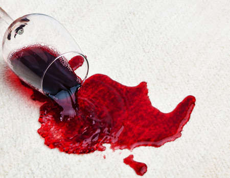 red wine stain: A glass of red wine was spilled on a carpet. Damage insurance.
