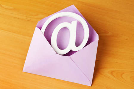In an envelope is sign an e-mail. Mail to electronic mail. photo