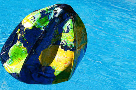 Water polo as a globe. The globe is made by the air pollution. photo
