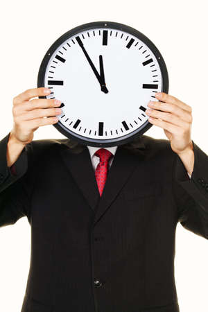 selfemployed: A manager in the head before stress with Clock. Working in the office. Stock Photo