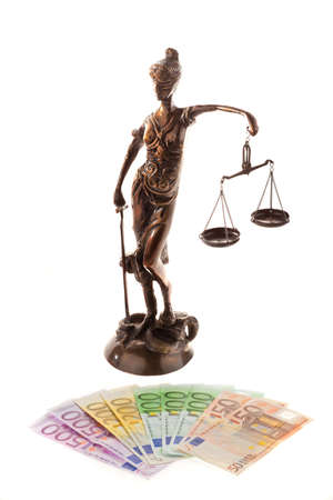 Justice with scales and ?. Cost of justice and court photo