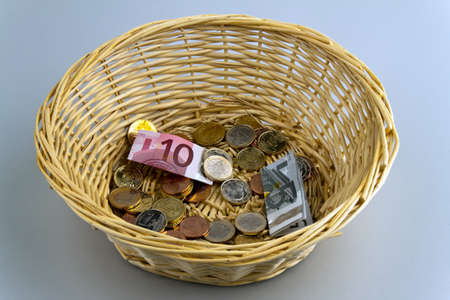 fundraising: A donation basket for collection. Monetary donation ?