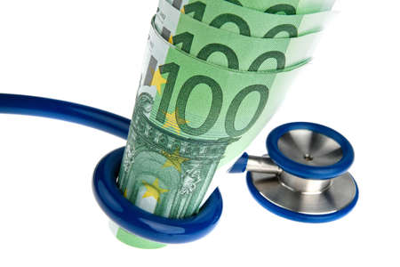Symbol for costs of health with ? and stethoscope photo