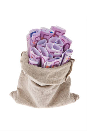A bag with lots of ? bills. Wealth. photo