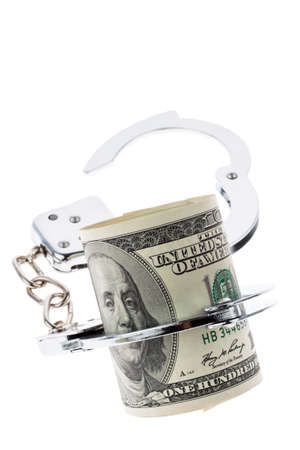 Many dollar bills with handcuffs. isolated on white photo