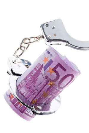 deeds: 500 euro banknote with handcuffs. Crime in the economy