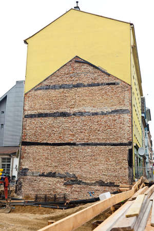 An old house demolition will be demolished. A new house is built. Stock Photo - 9118873