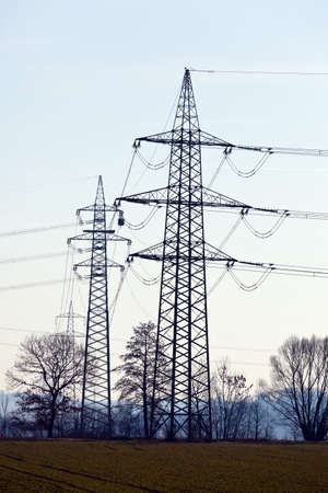 curren: Poles of a high-voltage power line. Production and transportation of energy. Stock Photo