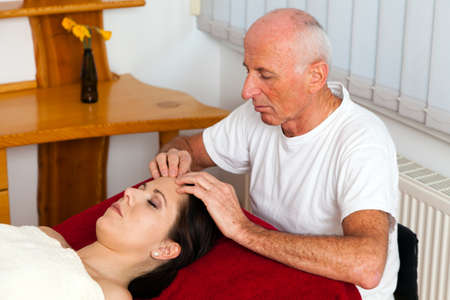 Relaxation, peace and well-being through massage. Head massage Stock Photo - 9199383