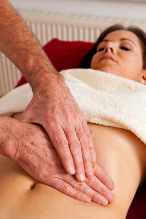 abdominal pain: Relaxation, peace and well-being through massage. Abdomen
