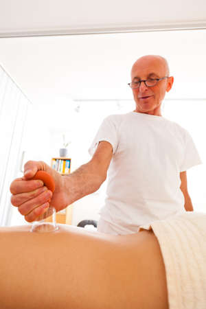 Relaxation, peace and well-being through massage. Cupping Massage photo