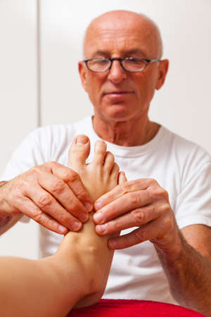 Relaxation, peace and well-being through massage. Reflexology Stock Photo - 9199322