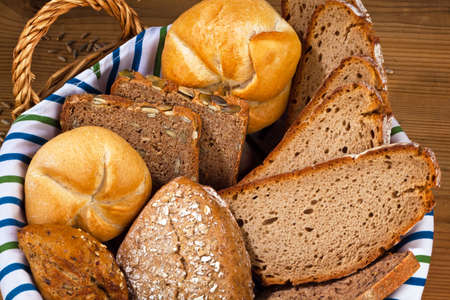 Several different kinds of bread. Healthy diet with fresh baked goods. Stock Photo - 9199876
