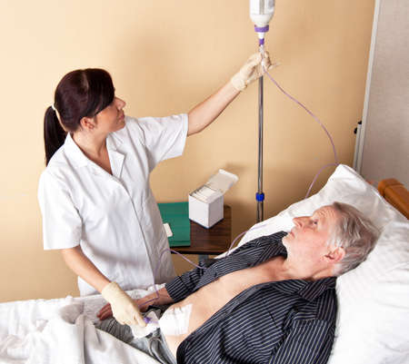 intravenously: A nurse gives a patient an infusion