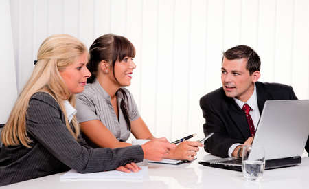 Husband and wife in a consultation. Business talk Stock Photo - 9199716
