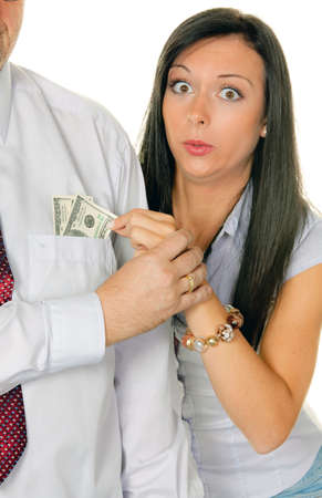 Young woman pulls a man out of the money Tasche.Dollar Stock Photo - 9260431