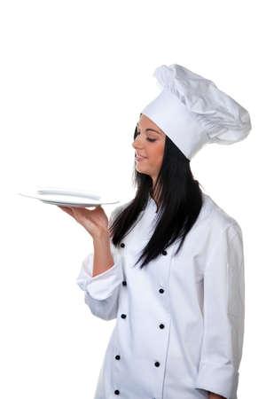Young female apprentice chef presents a silver tray Stock Photo - 9260035