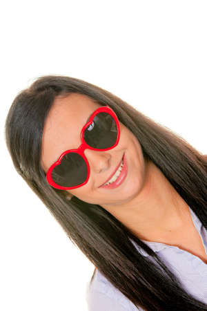 Young woman with heart haped sunglasses. Girl in love Stock Photo - 9260142
