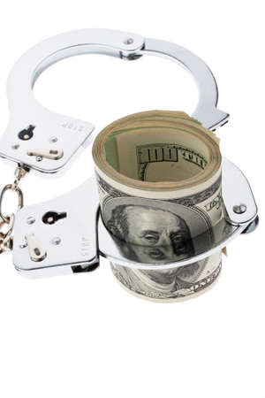 bribes: Many dollar bills with handcuffs. crime and economic crime. Stock Photo