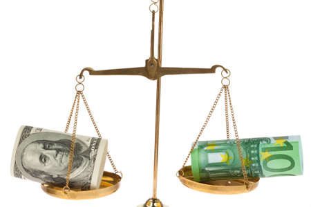 Euro banknotes and dollar on scales before a white background photo