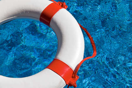 indebtedness: An emergency tire floating in a swimming pool. Example picture for aid, debt and bankruptcy