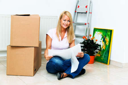 Woman with cardboard boxes on moving to the new apartment. Stock Photo - 9307770