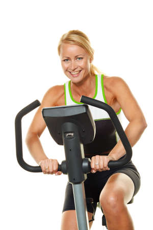 stamina: A young woman in training for endurance on the ergometer.