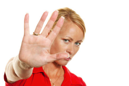defensive posture: A young woman holding hands in front of her face. Stock Photo