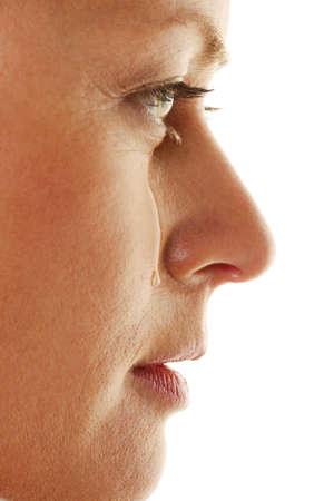 cries: Woman is sad and cries. Teardrop on his cheek.
