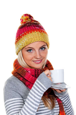 warms: Young woman with a hood warms up with hot tea.
