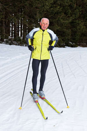 Senior at the snow in winter on cross country skis photo