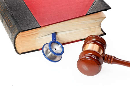 malpractice: A blue stethoscope is a medical book Stock Photo