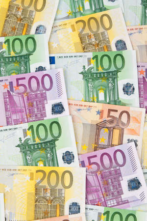 Many Euro banknotes of the European Union next to each other photo
