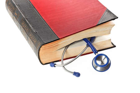 A blue stethoscope is a medical book photo