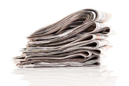 pile of newspapers: Old newspapers and magazines in a pile