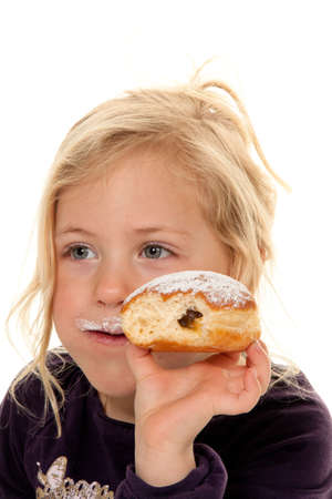 Child in a carnival, with donuts. Happy with the donuts photo