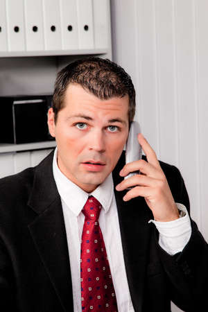 Young Business man in office with telephone Stock Photo - 9450153