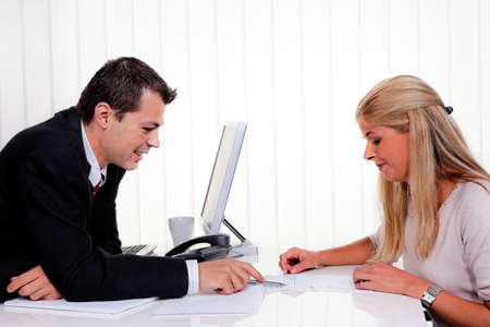 negotiation business: Husband and wife in a consultation in office Stock Photo