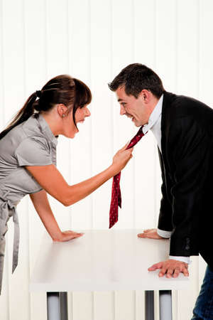 self contained: Dispute among employees at work in an office