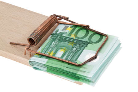 Many Euro banknotes in a mousetrap. Debts and loans photo