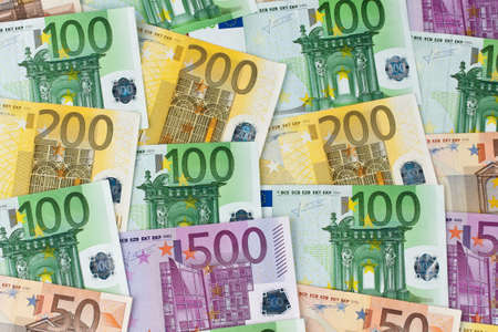 Many Euro banknotes of the European Union. Notes as a background photo