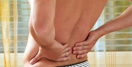 Sickness caused by pain in the back. Intervertebral disc and spinal column. Stock Photo - 9445468
