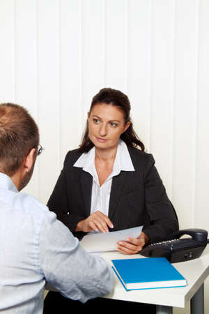 marriage counseling: Businesswoman reading a letter in the office. Message from the attorney or tax office.