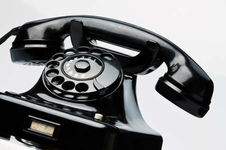 An old, old landline telephone. Phone on a white background. Stock Photo - 9450167