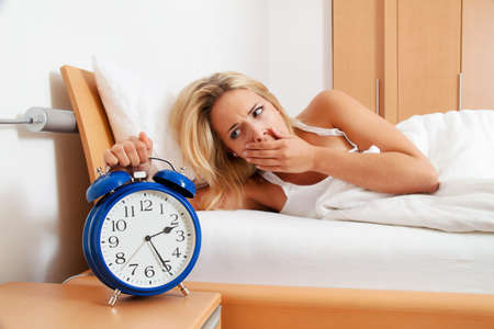 Clock with sleep at night. Woman can not sleep. Stock Photo - 9488552