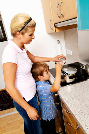 electric stove: A woman in the kitchen while cooking with electric stove